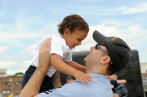 US_Navy_090722-N-8467N-006_Culinary_Specialist_1st_Class_Joseph_Appold_hugs_his_1-year-old_son_Kameron_upon_the_return_of_the_Virginia-class_attack_submarine_USS_New_Hampshire_(SSN_778)_to_Submarine_Base_New_London