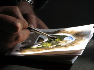 1024px-Dolceacqua43_-_Artista_locale_mentre_dipinge_un_acquarello
